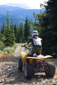 Quad rider on mountain trail near Donner summit, CA